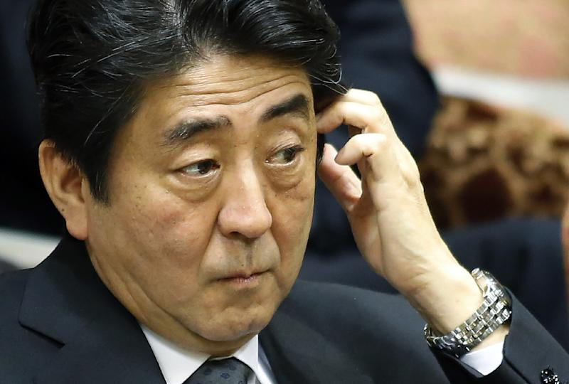Japanese Prime Minister Shinzo Abe listens to a question during a parliamentary session in Tokyo, on June 9, 2014