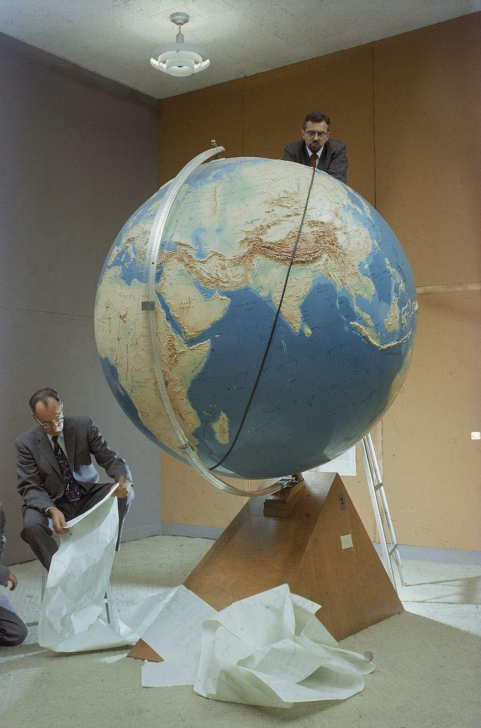 "<p>On October 19, the Soviet Union <a href=""https://www.sciencenews.org/article/90th-anniversary-issue-1950s"" rel=""nofollow noopener"" target=""_blank"" data-ylk=""slk:sends up Sputnik 1"" class=""link rapid-noclick-resp"">sends up Sputnik 1</a>. Here, Smithsonian Astrophysical Observatory scientists Dr. J. Allen Hynek and Dr. Fred Whipple plot the orbit of the satellite. </p>"