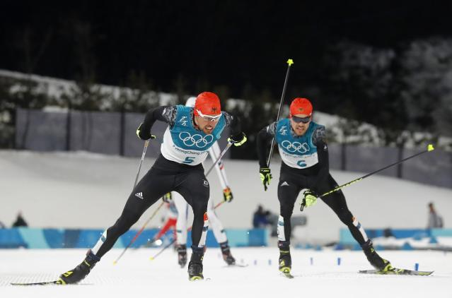 Nordic Combined Events - Pyeongchang 2018 Winter Olympics - Men's Individual 10 km Final - Alpensia Cross-Country Skiing Centre - Pyeongchang, South Korea - February 20, 2018 - Johannes Rydzek of Germany and Fabian Riessle of Germany before crossing the finish line. REUTERS/Kai Pfaffenbach