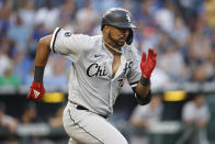 Chicago White Sox's Eloy Jimenez attempt to beat the throws to first base as he hit a ground ball during the fourth inning of a baseball game against the Kansas City Royals at Kauffman Stadium in Kansas City, Mo., Monday, July 26, 2021. (AP Photo/Colin E. Braley)