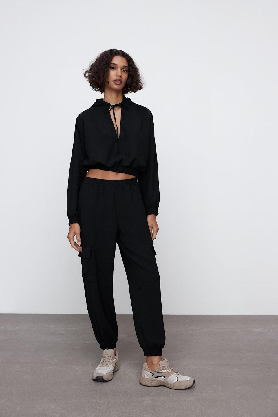 <p>This <span>Zara Flowy Cropped Sweatshirt</span> ($36) and <span>Cargo Joggers</span> ($36) set is classic, with a cute twist. We love the cutouts and tie details.</p>