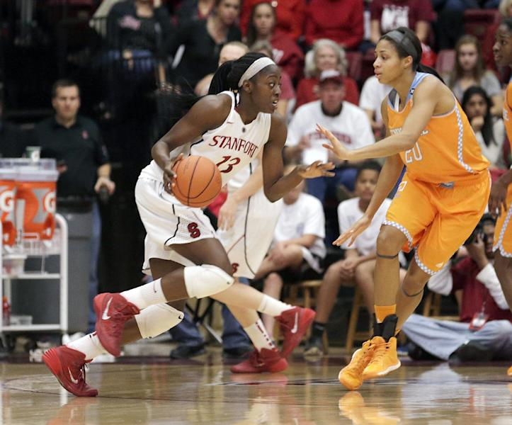 Stanford forward Chiney Ogwumike (13) looks to drive the ball against Tennessee center Isabelle Harrison (20) during the first half of an NCAA women's college basketball game, Saturday, Dec. 21, 2013, in Stanford, Calif. (AP Photo/Tony Avelar)