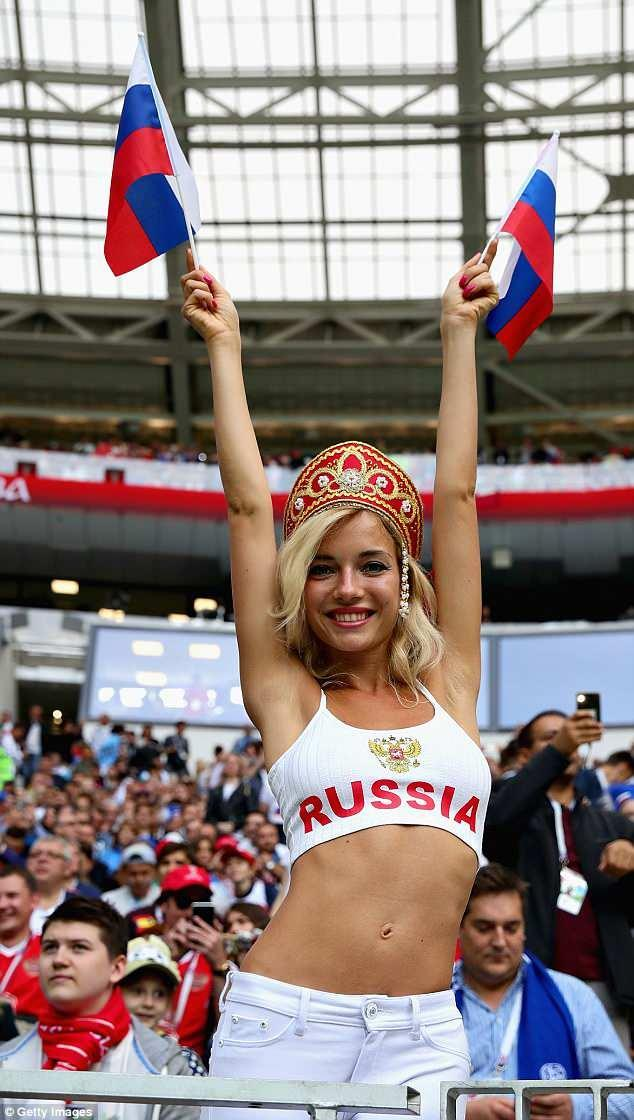 During the opening ceremony she was seen waving Russian flags