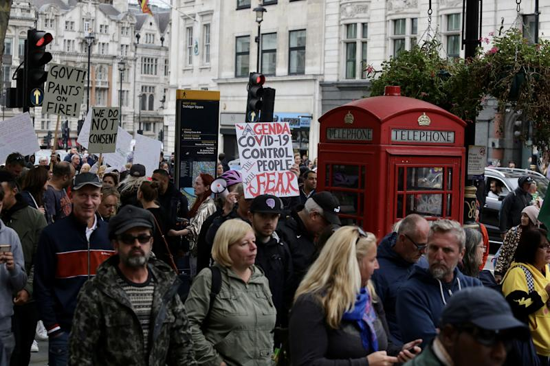 LONDON, UNITED KINGDOM - SEPTEMBER 26: Members of StandUpX, a community of people protesting vaccination and the novel coronavirus (COVID-19) measures, gather despite bans on bulk demonstrations due to the coronavirus, in London, United Kingdom on September 26, 2020. They attended a mass rally against wearing masks, taking test and government restrictions imposed to fight the spread of coronavirus pandemic. (Photo by Hasan Esen/Anadolu Agency via Getty Images)