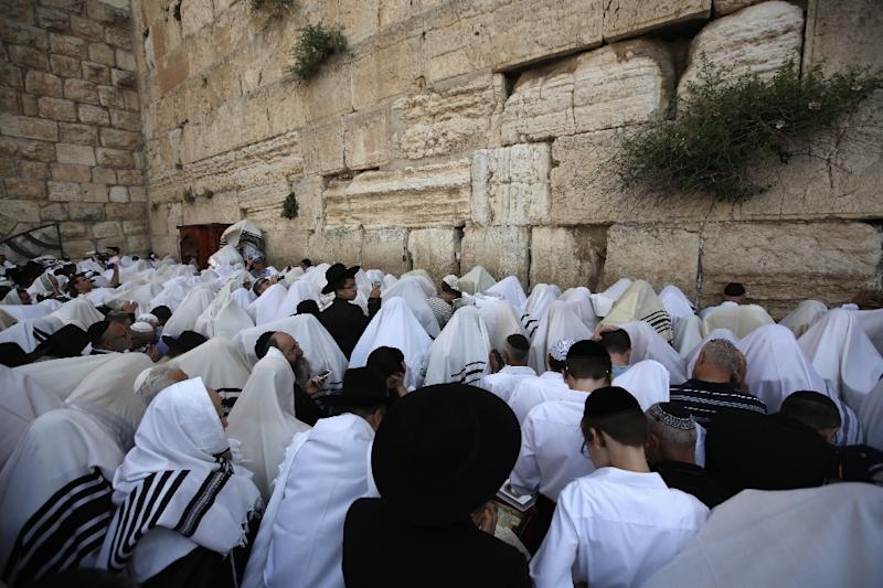 Thousands of Jews visit the Western Wall in east Jerusalem's Old City during Yom Kippur, or Day of Atonement, which ends on Wednesday evening