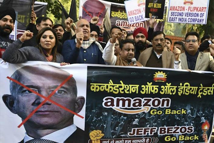 Hundreds of small traders staged protests during his visit to the giant South Asian market this week, which came as anti-trust authorities launched a probe into Amazon and its main rival Walmart-owned Flipkart (AFP Photo/Sajjad HUSSAIN)