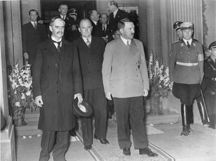 Picture from German Feberal Archives showing then British prime minister Neville Chamberlain with German leader Adolph Hitler, Munich 1938.