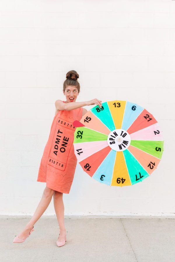 """<p>If you love state fairs and carnivals, this is the costume for you! Just spin to win (it's actually a white parasol!). </p><p><strong>Get the tutorial at</strong><strong> <a href=""""https://studiodiy.com/diy-carnival-game-costume/"""" rel=""""nofollow noopener"""" target=""""_blank"""" data-ylk=""""slk:Studio DIY"""" class=""""link rapid-noclick-resp"""">Studio DIY</a>. </strong></p><p><a class=""""link rapid-noclick-resp"""" href=""""https://www.amazon.com/Forum-Novelties-Womens-Novelty-Parasol/dp/B003JM8VNO/ref=sr_1_17?dchild=1&keywords=white+parasol&qid=1592330238&sr=8-17&tag=syn-yahoo-20&ascsubtag=%5Bartid%7C10050.g.21600836%5Bsrc%7Cyahoo-us"""" rel=""""nofollow noopener"""" target=""""_blank"""" data-ylk=""""slk:SHOP WHITE PARASOLS"""">SHOP WHITE PARASOLS</a></p>"""