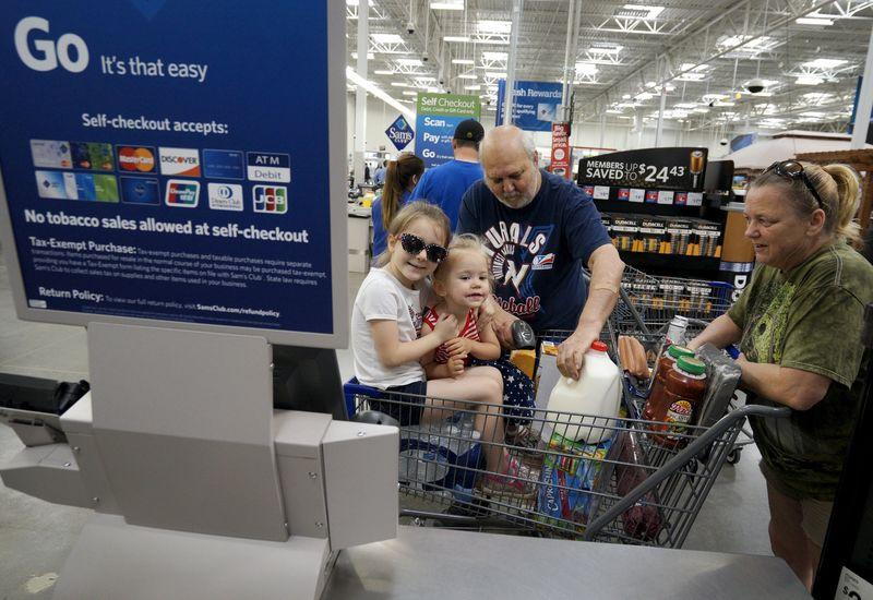 A family uses the self-checkout at the Wal-Mart owned Sam's Club in Bentonville