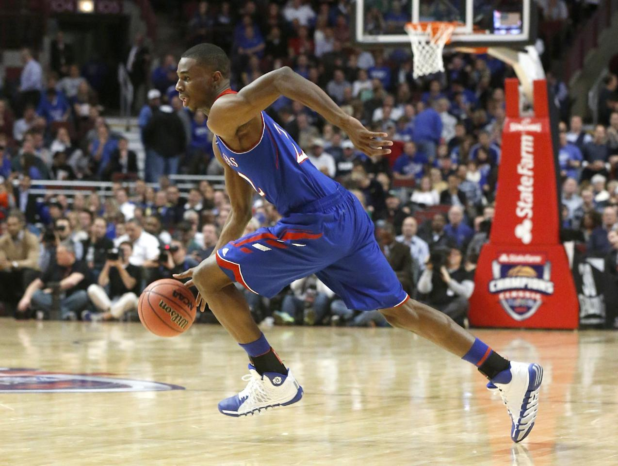 Kansas guard Andrew Wiggins drives to the basket during the second half of an NCAA college basketball game against Duke, Tuesday, Nov. 12, 2013, in Chicago. (AP Photo/Charles Rex Arbogast)