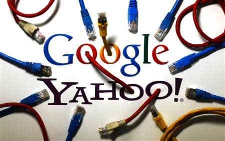 An illustration picture shows logos of Google and Yahoo connected with LAN cables in Berlin