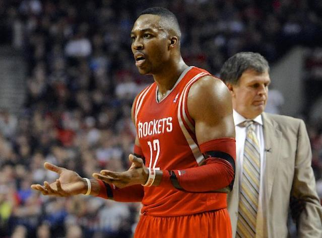 Houston Rockets' Dwight Howard (12) questions a technical foul called on him during the first half of game four of an NBA basketball first-round playoff series game against the Portland Trail Blazers in Portland, Ore., Sunday March 30, 2014. (AP Photo/Greg Wahl-Stephens)