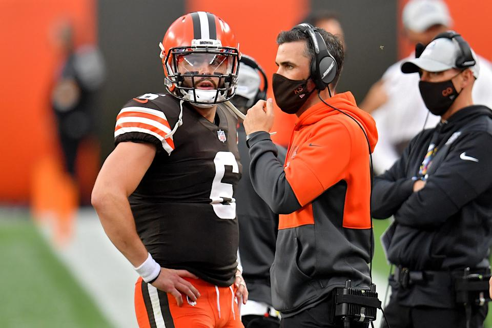 CLEVELAND, OHIO - OCTOBER 11: Baker Mayfield #6 of the Cleveland Browns meets with head coach Kevin Stefanski in the second quarter against the Indianapolis Colts at FirstEnergy Stadium on October 11, 2020 in Cleveland, Ohio. (Photo by Jason Miller/Getty Images)