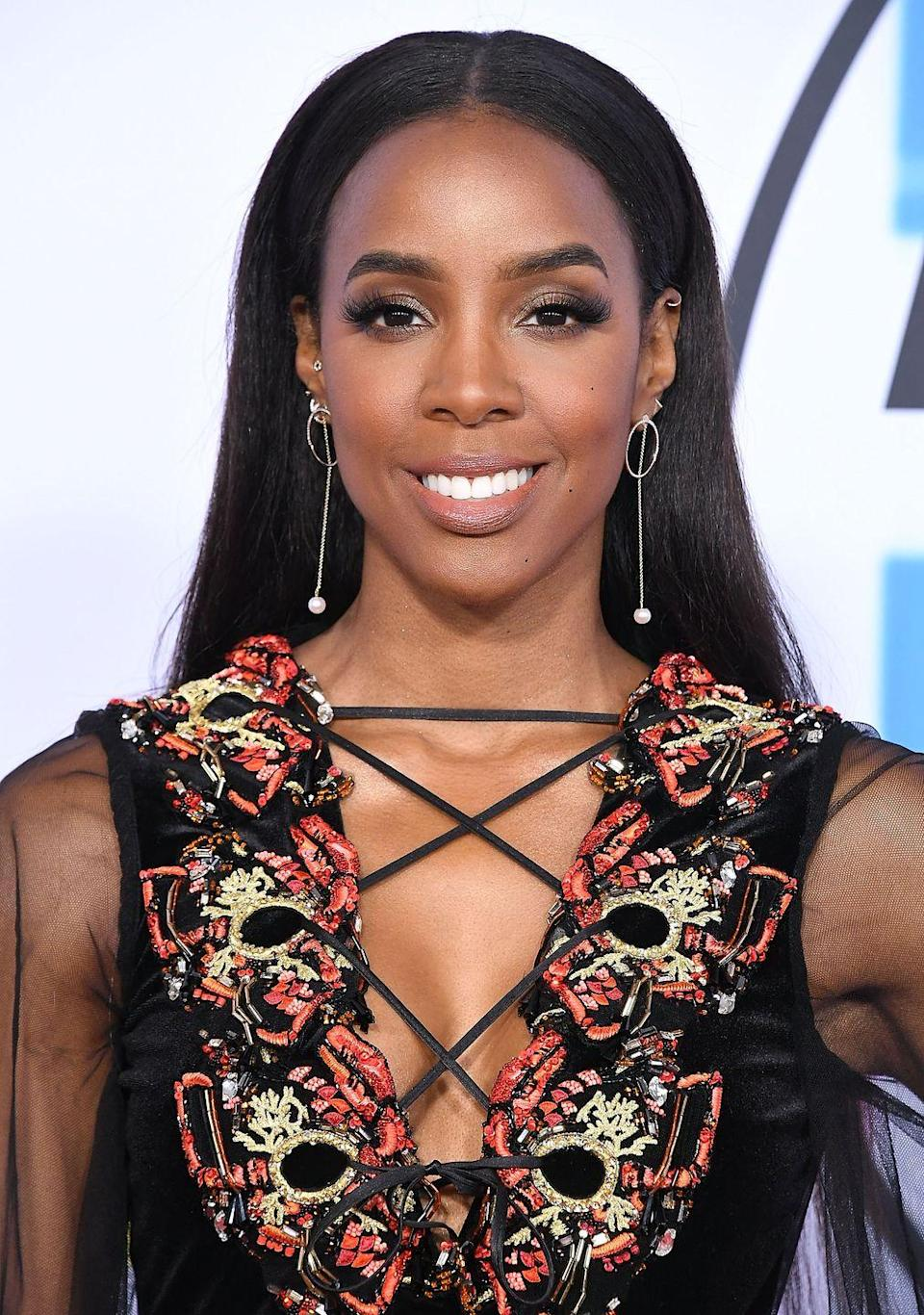 """<p>""""I wanted to get breast implants when I was 18, but my mom and Beyoncé's mom told me to really think about it first,"""" the former Destiny's Child singer told <a href=""""http://www.shape.com/blogs/fit-famous/kelly-rowland-flaunts-her-x-factor-cover-shape"""" rel=""""nofollow noopener"""" target=""""_blank"""" data-ylk=""""slk:Shape magazine"""" class=""""link rapid-noclick-resp"""">Shape magazine</a>. """"I took their advice and waited 10 years.""""</p>"""
