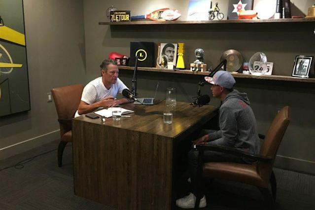 Armstrong talks with golfer Rickie Fowler in the former pro cyclist's studio in Austin in April. (Photo courtesy Mark Higgins)