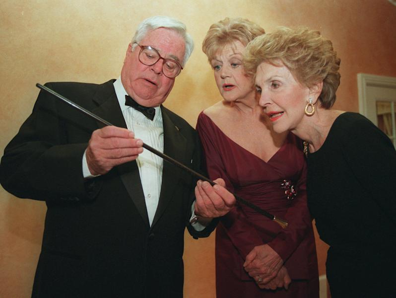 "FILE - In this March 23, 1996 file photo, William Windom, left, shows a swagger stick to ""Murder She Wrote"" star Angela Lansbury, center, and former first lady Nancy Reagan prior to Lansbury being presented the Caritas Award by Mrs. Reagan in Beverly Hills, Calif. Windom, who won an Emmy Award for his turn in the TV comedy series ""My World And Welcome To It,"" died Thursday, Aug. 16, 2012 of congestive heart failure at his home in Woodacre, north of San Francisco. He was 88. (AP Photo/Frank Wiese)"