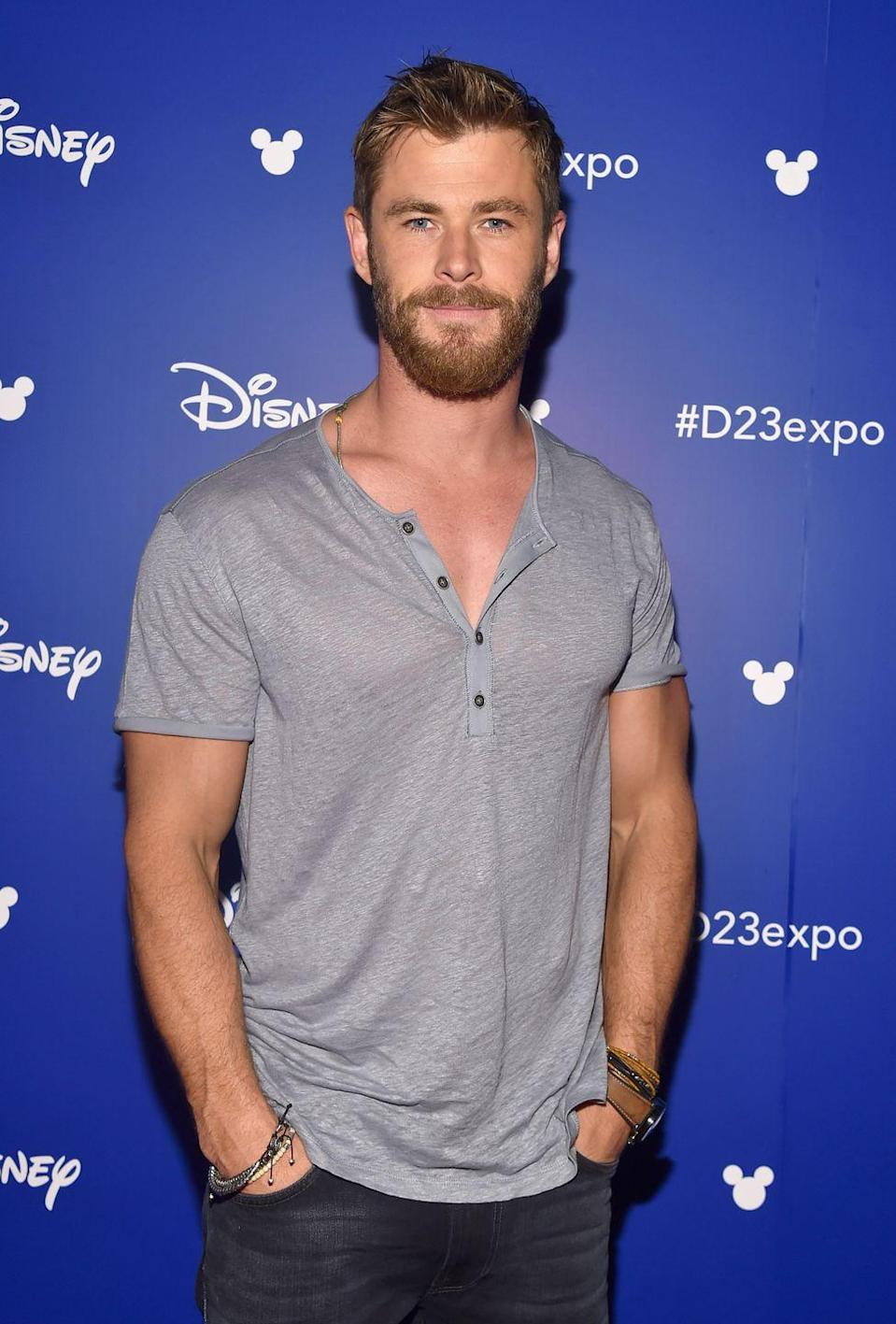 <p>Chris Hemsworth is a modest guy, so he doesn't need to flex to show off his muscles. Instead, the Australian star keeps it real in a relaxed t-shirt at Disney's D23 Expo in 2018. </p>