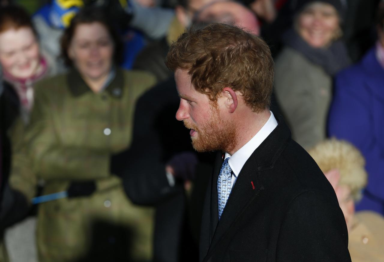 Britain's Prince Harry walks to a Christmas Day morning service at the church on the Sandringham Estate in Norfolk