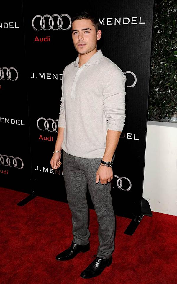 """Zac Efron paired a bone-colored top with too-tight gray pants and a newly-shorn 'do. Do you think his look is hot ... or not? Jason Merritt/<a href=""""http://www.gettyimages.com/"""" target=""""new"""">GettyImages.com</a> - January 9, 2011"""