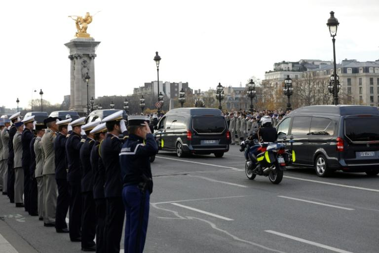 Soldiers saluted as the funeral convoy passed by and hundreds lined the streets (AFP Photo/GEOFFROY VAN DER HASSELT)
