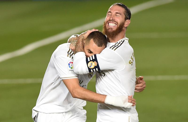 MADRID, SPAIN - JULY 16: Karim Benzema of Real Madrid celebrates with Sergio Ramos after he scored the second goal from a penalty during the Liga match between Real Madrid CF and Villarreal CF at Estadio Alfredo Di Stefano on July 16, 2020 in Madrid, Spain. (Photo by Denis Doyle/Getty Images)