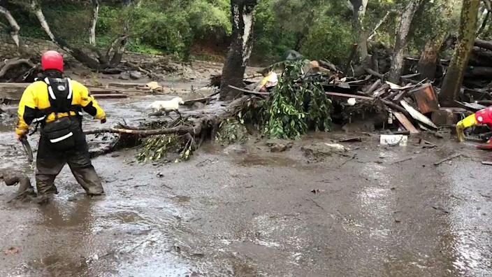 <p>Emergency personnel search through debris and mud flow after a mudslide in Montecito, Calif., Jan. 9, 2018. (Photo: Mike Eliason/Santa Barbara County Fire Department/Handout via Rreuters) </p>