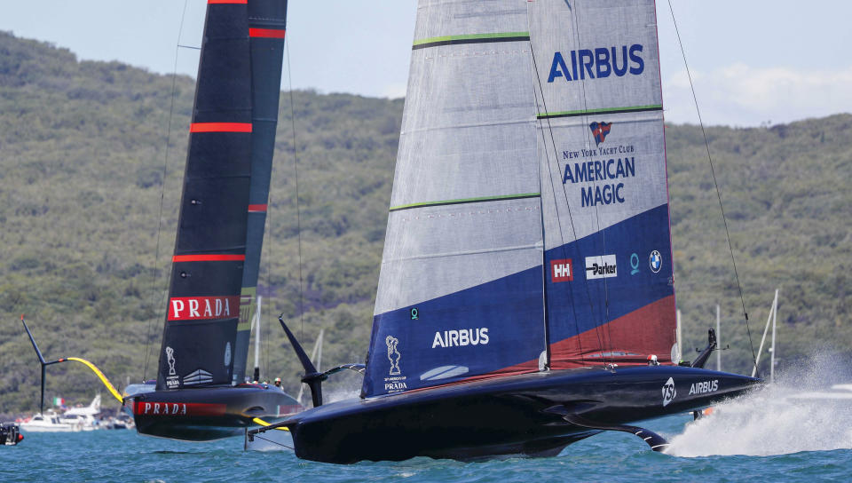 American Magic, right, races Italy's Luna Rossa in the America's Cup challenger series semifinals on Auckland's Waitemate Harbour, New Zealand, Saturday, Jan. 30, 2021. (Dean Purcell/NZ Herald via AP)