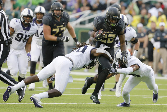 Terence Williams (22) rushed for 1,859 yards and 15 touchdowns in three years at Baylor. (AP Photo/Tony Gutierrez, File)