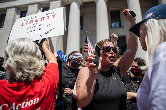 """A Black Lives Matter counterprotester chants slogans during an """"anti-mask"""" rally at the Ohio Statehouse in Columbus. (Megan Jelinger/SOPA Images/LightRocket via Getty Images)"""