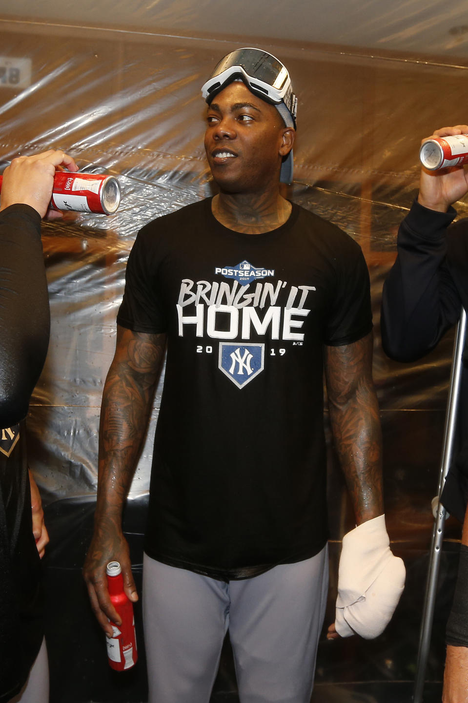 Aroldis Chapman's pitching hand was in a heavy wrap after he says he was hit with a bottle in the clubhouse. (Getty)