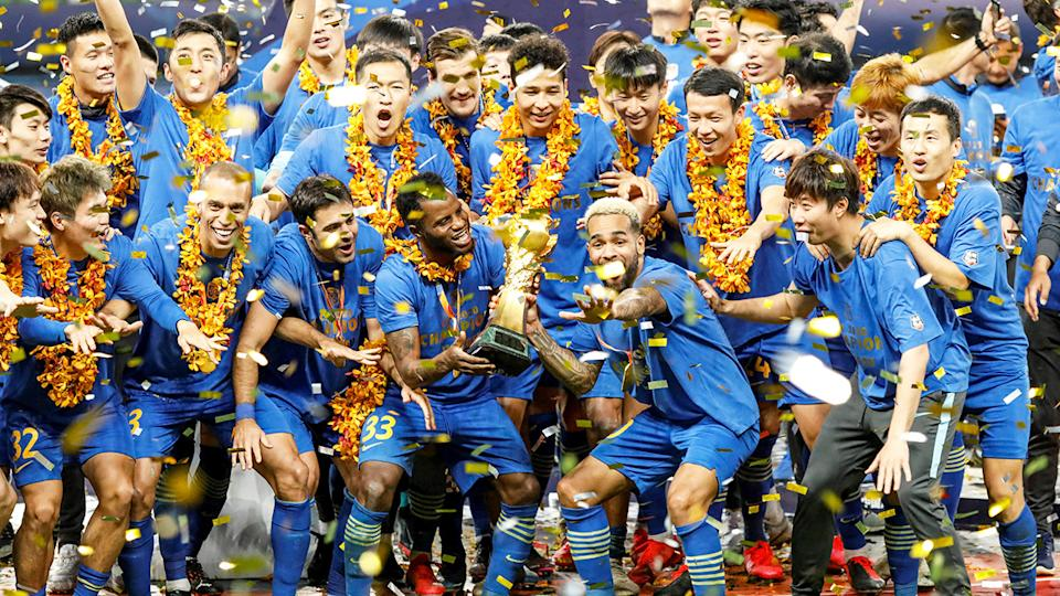 Jiangsu Suning players and staff, pictured here celebrating winning the Chinese Super League title.