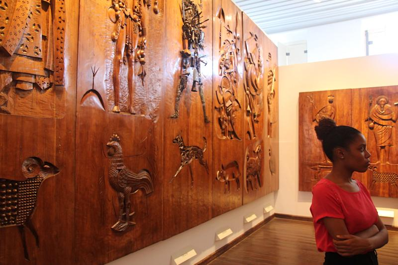 A young Brazilian girl gazes at the carvings of Afro-Brazilian orishas in wood by the Argentine-born artist Carybé in the Afro-Brazilian Museum in Salvador, Bahia.