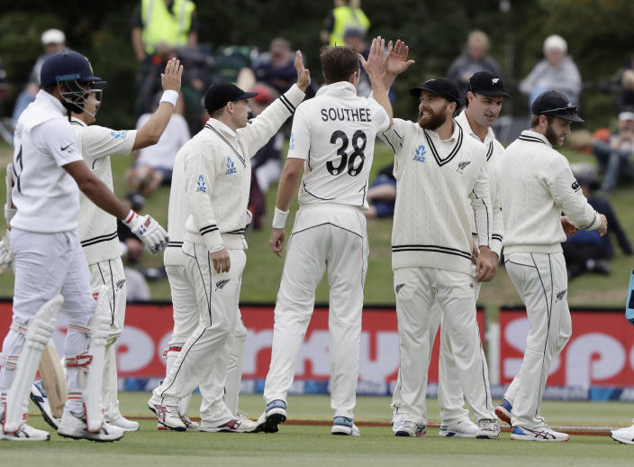 New Zealand players celebrate the dismissal of India's Mohammed Shami, left, during play on day three of the second cricket test between New Zealand and India at Hagley Oval in Christchurch, New Zealand, Monday, March 2, 2020. (AP Photo/Mark Baker)