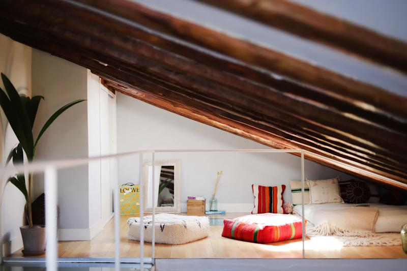 Floor cushions from Marrakech provide a bed of comfort for friends to relax and chat on in the dreamy loft.
