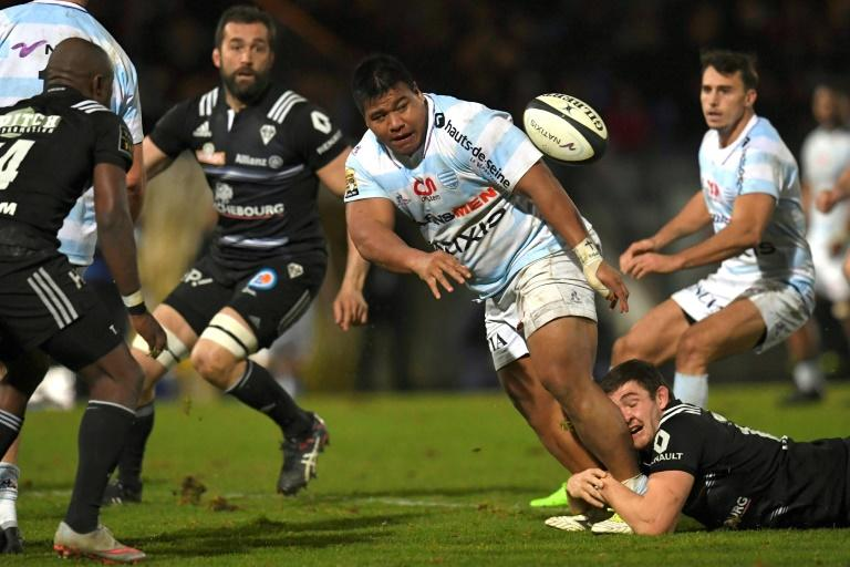 Racing 92' Viliamu Afatia (C) passes the ball during their French Top 14 rugby union match against Brive, at the Yves Du Manoir stadium in Colombes, on February 18, 2017