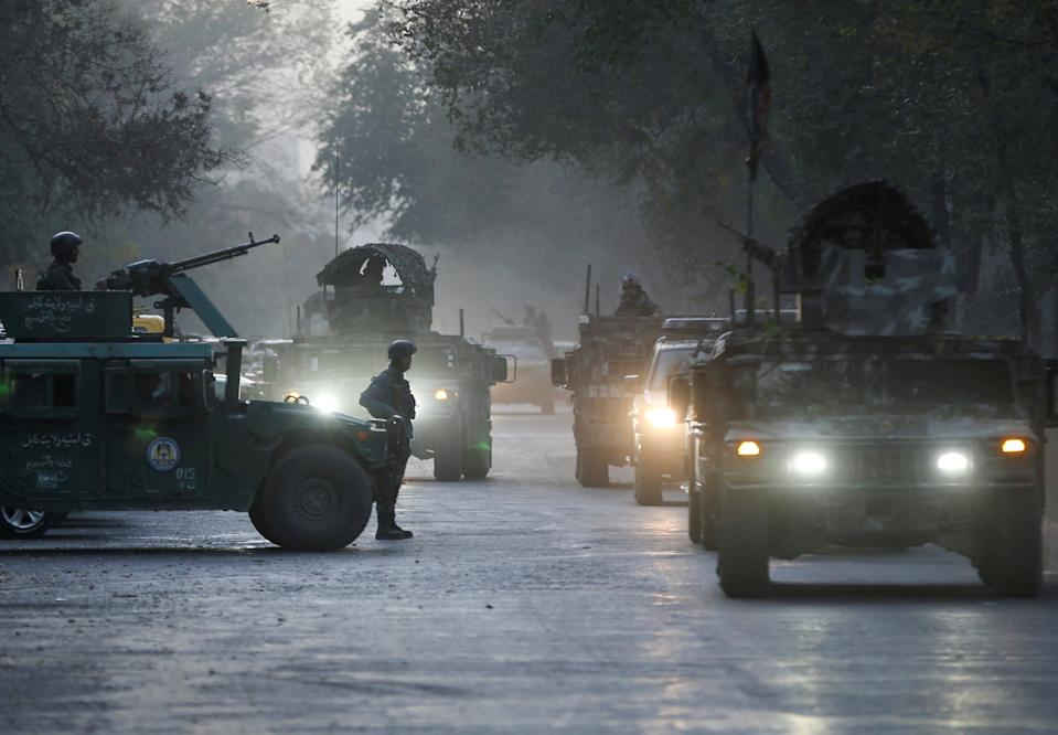 Afghan security forces leave the site of an incident after an attack at the university of Kabul.