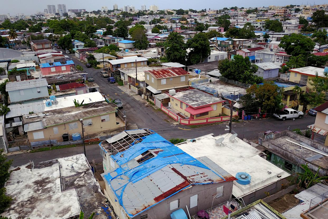 Roughly 30,000 homes in Puerto Rico still are sheltered in part by blue tarps federal officials gave out after 2017's Hurricane Maria ravaged the island. (Photo: RICARDO ARDUENGO via Getty Images)