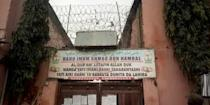 A sign is seen above a house where police rescued men and boys in Kaduna