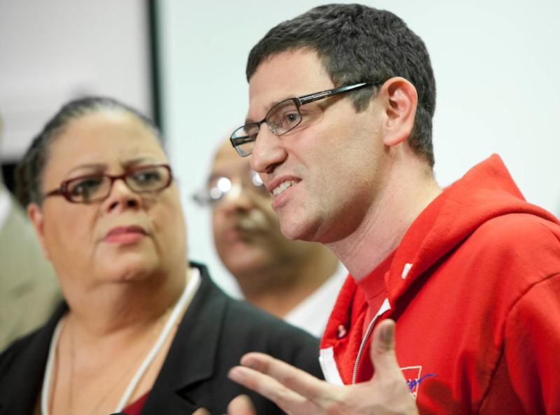 Chicago Teachers Union President Karen Lewis, left, listens to CTU Vice President Jesse Sharkey speak at a press conference following a meeting of delegates Sunday, Sept. 16, 2012 in Chicago. The Chicago teachers union decided Sunday to continue its weeklong strike, extending an acrimonious standoff with Mayor Rahm Emanuel over teacher evaluations and job security provisions central to the debate over the future of public education across the United States. (AP Photo/Sitthixay Ditthavong)