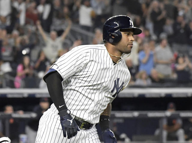 New York Yankees' Aaron Hicks rounds the bases with a home run during the sixth inning of a baseball game against the Detroit Tigers, Friday, Aug. 31, 2018, at Yankee Stadium in New York. (AP Photo/Bill Kostroun)