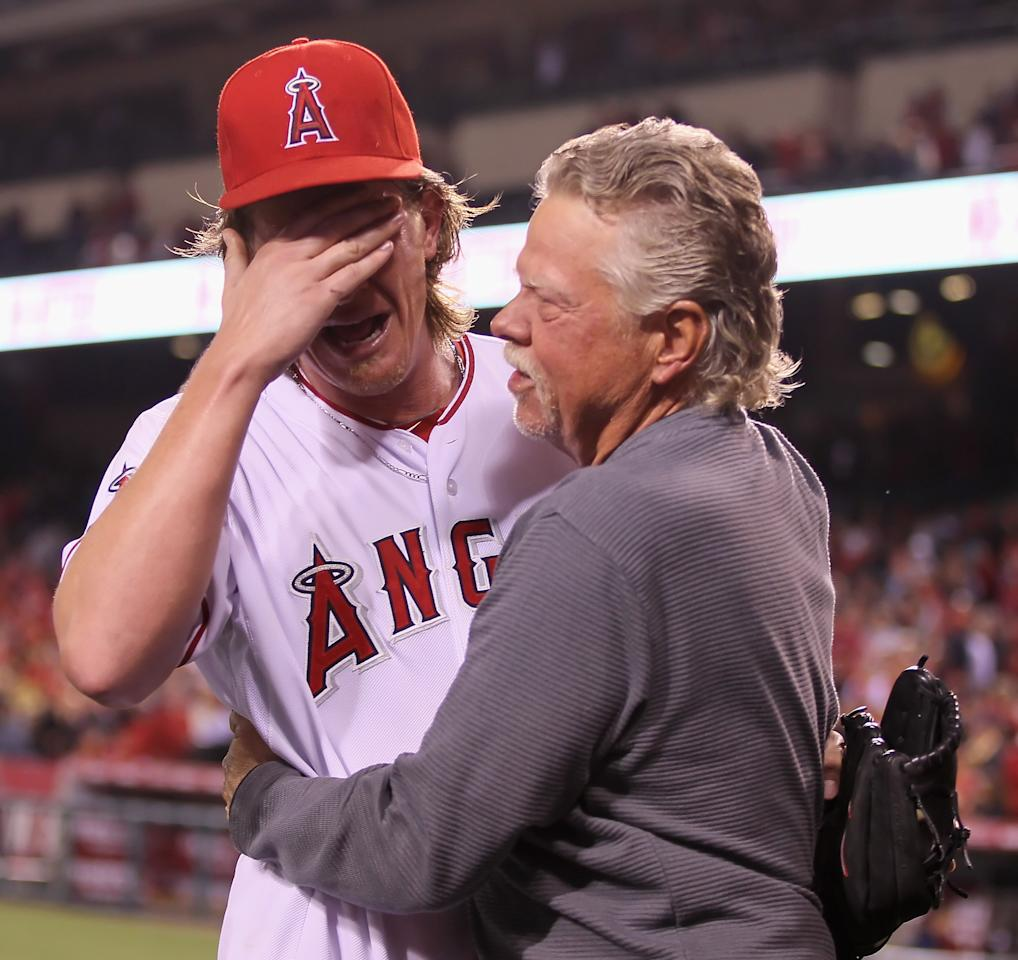 ANAHEIM, CA - MAY 02:  Starting pitcher Jered Weaver #36 of the Los Angeles Angels of Anaheim celebrates with his dad Dave after throwing a no-hitter against the Minnesota Twins at Angel Stadium of Anaheim on May 2, 2012 in Anaheim, California. The Angels defeated the Twins 9-0.  (Photo by Jeff Gross/Getty Images)
