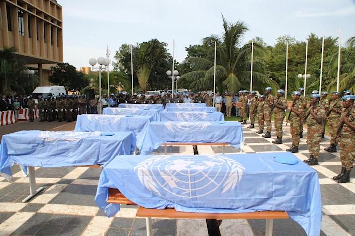 The coffins of nine UN soldiers are draped with UN flags during a service at the headquarters of MINUSMA, the UN mission in Mali on October 7, 2014 in Bamako (AFP Photo/Habibou Kouyate)