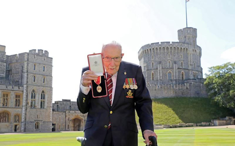 Fundraising UK veteran Sir Captain Tom Moore receives knighthood from the Queen at Windsor Castle - Chris Jackson/Reuters