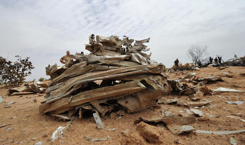 Debris from Air Algerie Flight AH 5017 scattered at the crash site in Mali's Gossi region, west of Gao, on July 26, 2014