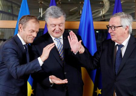 FILE PHOTO: Ukraine's President Petro Poroshenko is welcomed by President of the European Council Donald Tusk and European Commission President Jean-Claude Juncker at the Europa building in Brussels, Belgium March 20, 2019. Frank Augstein/Pool via REUTERS/File Photo