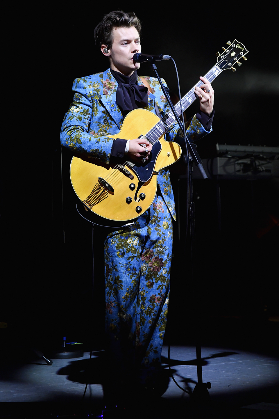 """<p>I'm pretty sure this is the same Gucci suit from the """"Kiwi"""" video, but it's so beautiful that it deserves to be in this slideshow twice. Harry wore it for his show at the Greek Theatre in Los Angeles. </p>"""