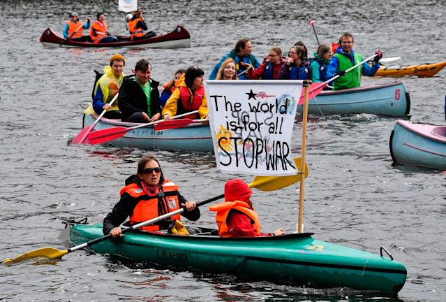 <p>Protest boats pass on the Alster river are pictured during a demonstration called by several NGOs ahead of the G20 summit in Hamburg on July 2, 2017. (John MacDougall/AFP/Getty Images) </p>
