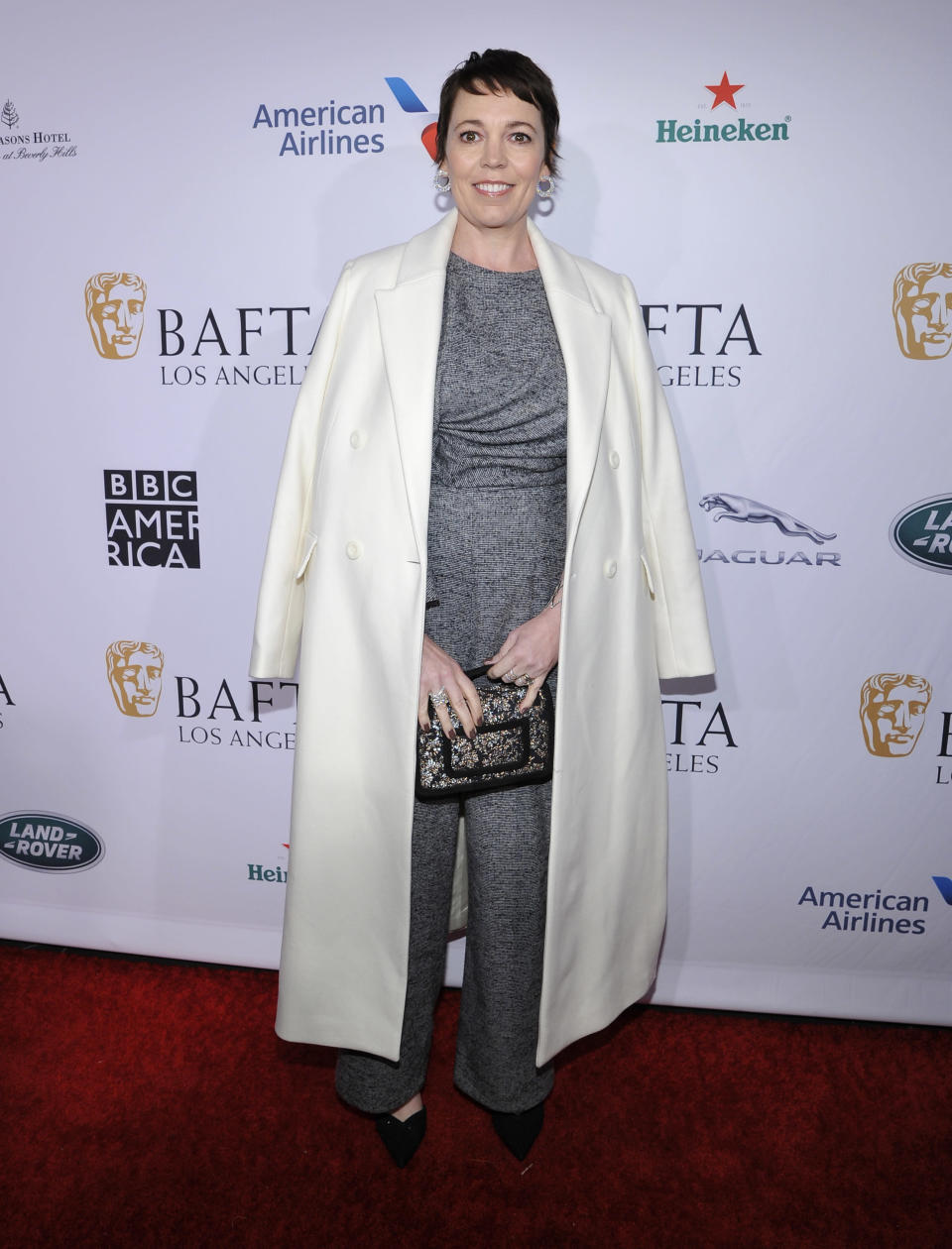 <p>The actress chose a grey jumpsuit with a tailored coat draped over her shoulders for the BAFTA Tea Party. <em>[Photo: Getty]</em> </p>