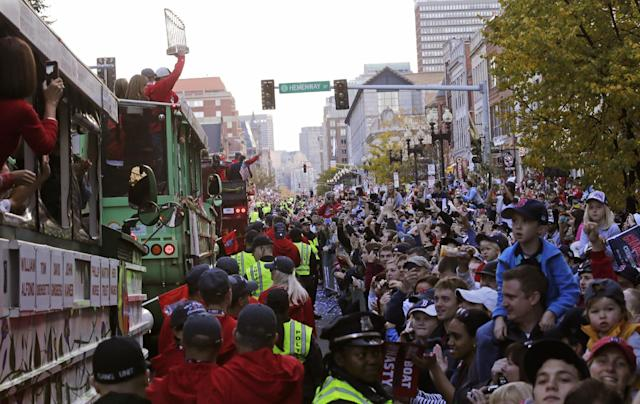 Boston Red Sox fans line Boylston Street during a parade in celebration of the baseball team's World Series win, Saturday, Nov. 2, 2013, in Boston. (AP Photo/Charles Krupa)