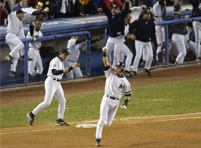 FIEE - In this Oct. 31, 2001, file photo, New York Yankees' Derek Jeter celebrates his game-winning home run in the 10th inning as he rounds first base in Game 4 of baseball's World Series against the Arizona Diamondbacks at Yankee Stadium in New York. Jeter could be a unanimous pick when Baseball Hall of Fame voting is announced Tuesday, Jan. 21, 2020. (AP Photo/Bill Kostroun, File)